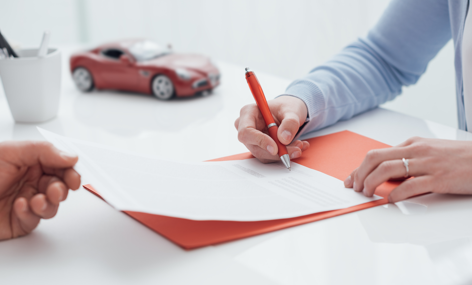 Woman Signing A Car Insurance Policy